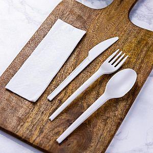 Одноразовый набор столовых приборов из кукурузного крахмала (нож, вилка, ложка, салфетка), в пачке 250 шт